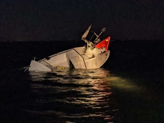 Six boaters were rescued overnight when their 30-foot white pleasure craft struck a fixed aid to navigation off Beach Haven, the US Coast Guard said.