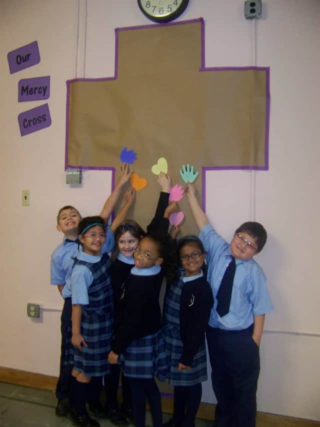 Students at Visitation Academy are encouraged to fill Mercy Cross with hearts and hands full of Works of Mercy.