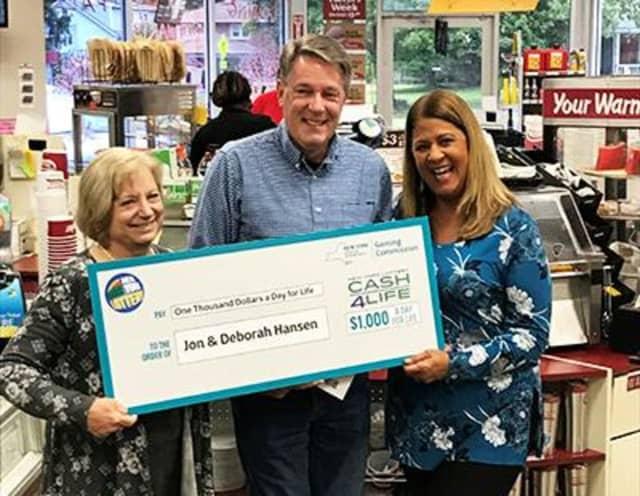 Jon and Deborah Hansen show off their big check.