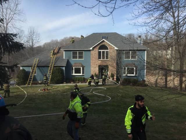 Firefighters battling a structure fire in Croton.