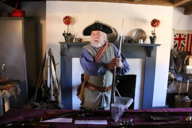 A period re-enactor welcomes guests to the Dey Mansion in Wayne.