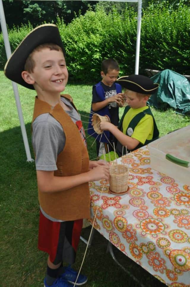 Children participating in a program at The Newtown Historical Society. The Newtown Historical Society is sponsoring an open house on May 15, from noon-4.