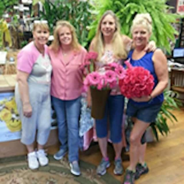 MariEllyn Dykstra-Donnellan, shown with employees, said Dykstra's Florist will close at the end of the year.