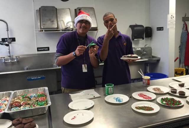 Volunteers prepare dessert for Meals with a Mission in Garfield.