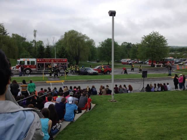 Somers High School students watch a mock drunken driving accident last year. The school is registering students for its driver education program.