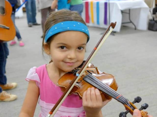 A young Thurnauer Music School musician and her violin. Celebrate Chanukah in Tenafly with music Dec. 6.