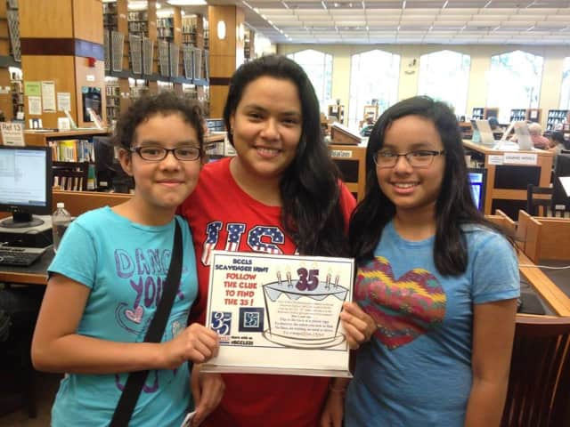 Teens hang out at the Johnson Public Library after a scavenger hunt.