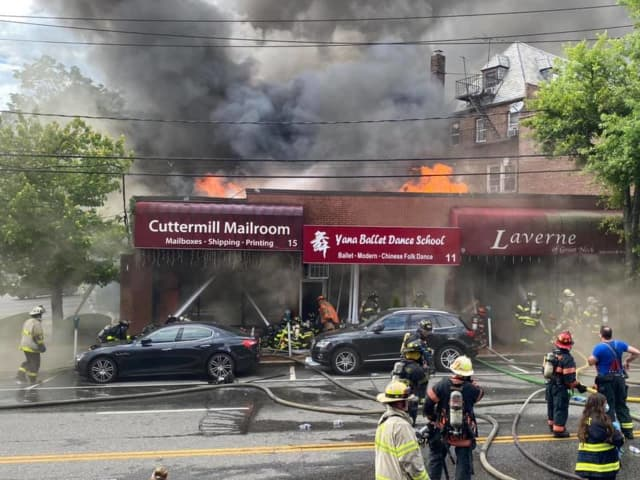 A massive five-alarm fire destroyed four businesses in Great Neck.