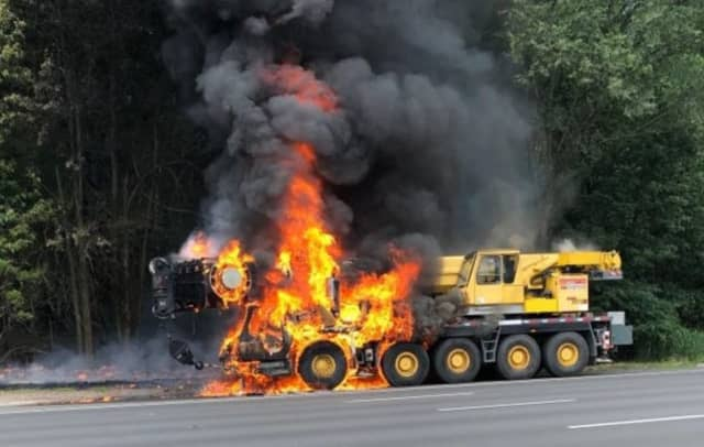 The mobile crane fire on Route 80W in Woodland Park.