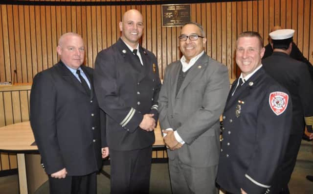 Christopher Di Bella, John Hayowyk, and John J. Tuohy of the Passaic Fire Department with Mayor Alex D. Blanco.