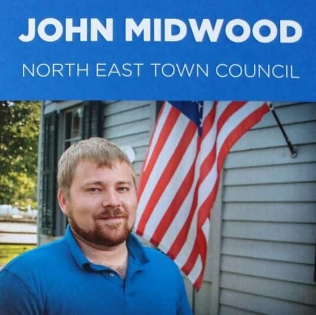 Democrat John Midwood most likely wins the race for the North East Town Council, but that could change once the 62 absentee ballots are all accounted for, The Poughkeepsie Journal said.
