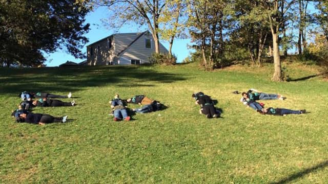Garfield teens spell out the name of their EPIC group.