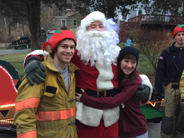 West Milford firefighters with Santa in 2014.