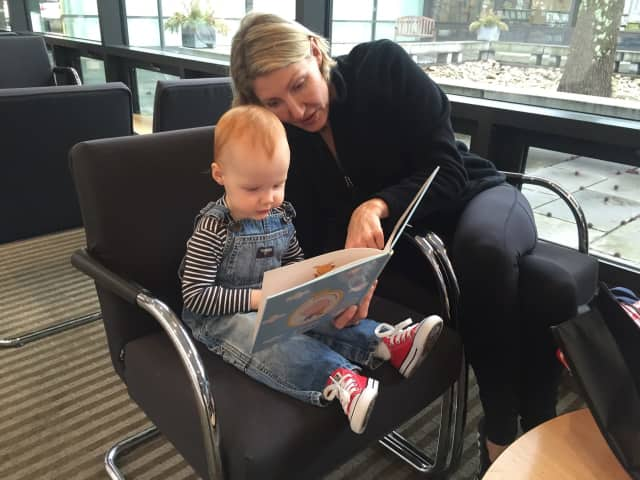 Lola is now eligible for her very own library card at Wilton Library during September's Library Card Sign-up Month now that the age requirement has been eliminated. Lola's mom Alexandra Norris is getting a good start at reading books to her.