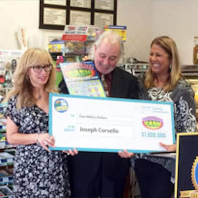 Joseph Corsello of Stormville shows off his $1 million check.