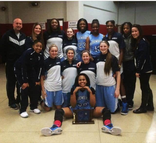The Lodi Immaculate girls basketball team celebrates its 2015 sectional championship. This year's team was named the top seed in the county tournament.