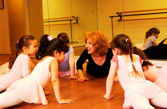Betsy Daly gets low with young ballerinas at the Cresskill Performing Arts Center.