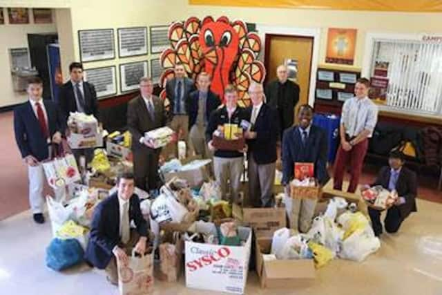 Students and staff members at Iona Preparatory, an all-boys Catholic school in New Rochelle, were able to gather up three busloads of food for families in need this Thanksgiving.
