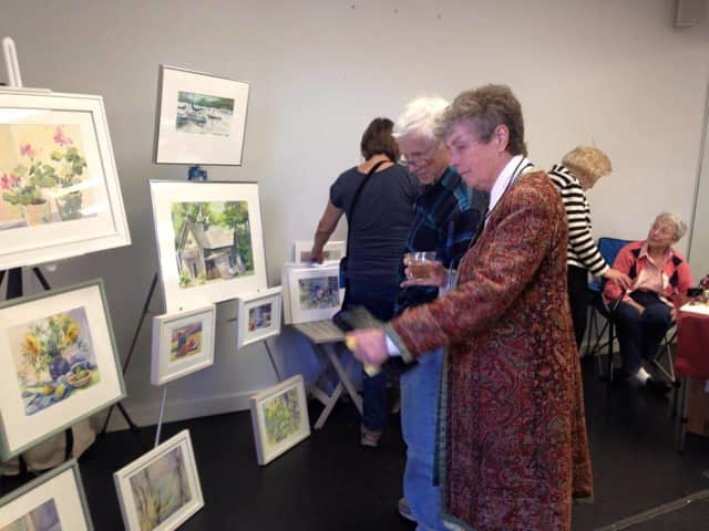 Guests browse the exhibits at the original arts gala in Harrington Park.