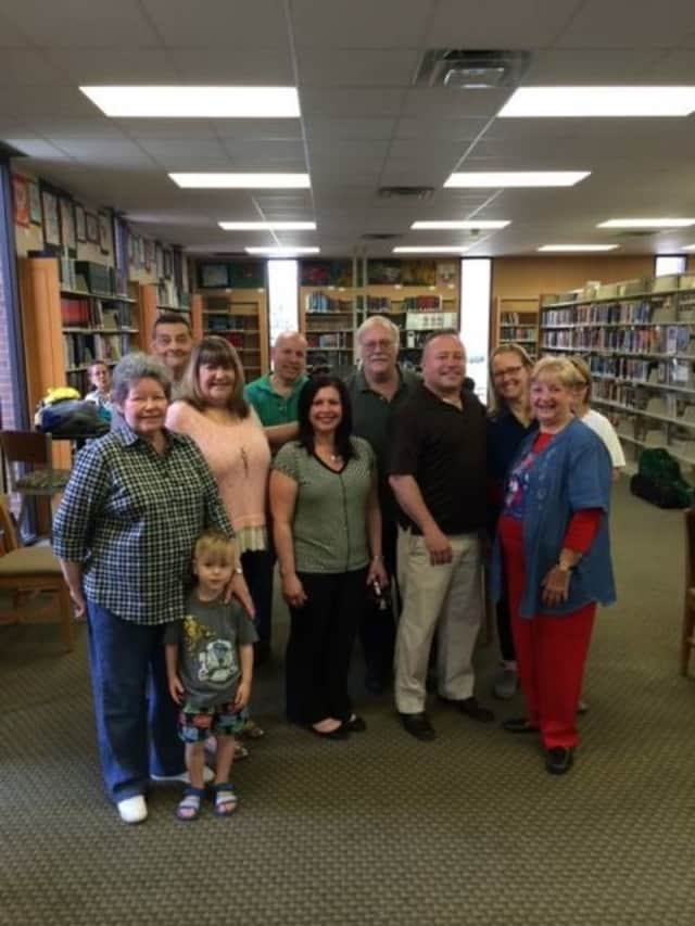 Elected officials library trustees (and their grandchildren!) cheer the 75th anniversary.