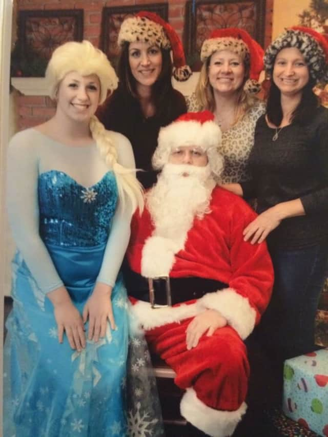 "The ""Bad Girls"" with Santa (Chuck Kohout), from left,  Derek Danbe, Brian Danbe, and Jocelyn Danbe."