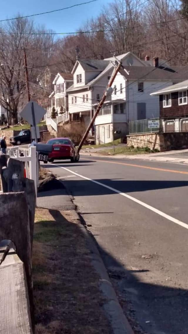 A car hit a pole at 204 Bridgeport Ave. in Shelton, causing a small power outage in the neighborhood.