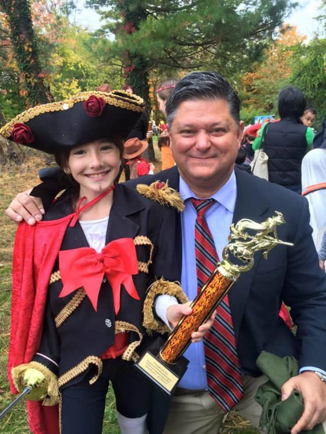 Councilman Carlos Rendo hangs out with a young pirate at a Halloween party in Woodcliff Lake.