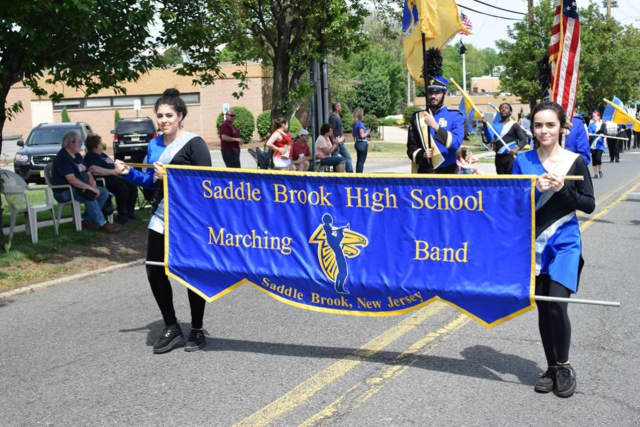 The Saddle Brook High School Marching Band lead the Memorial Day Parade.
