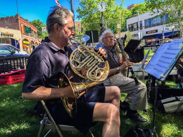 Musicians perform a concert June 13 at the Hartsdale Farmers Market in Greenburgh, N.Y.
