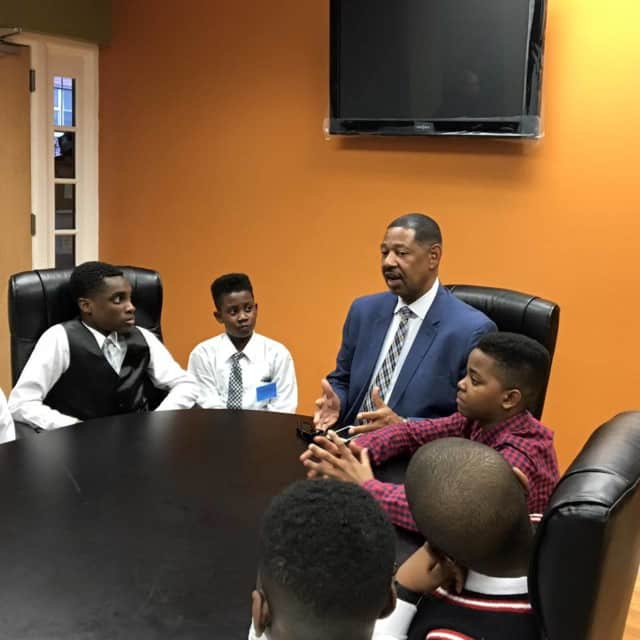 Mount Vernon Schools Superintendent Kenneth Hamilton with several students.