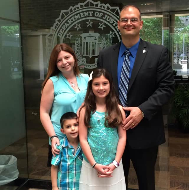 East Rutherford Police Captain Phil Taormina receives his diploma from the FBI National Academcy with his family.