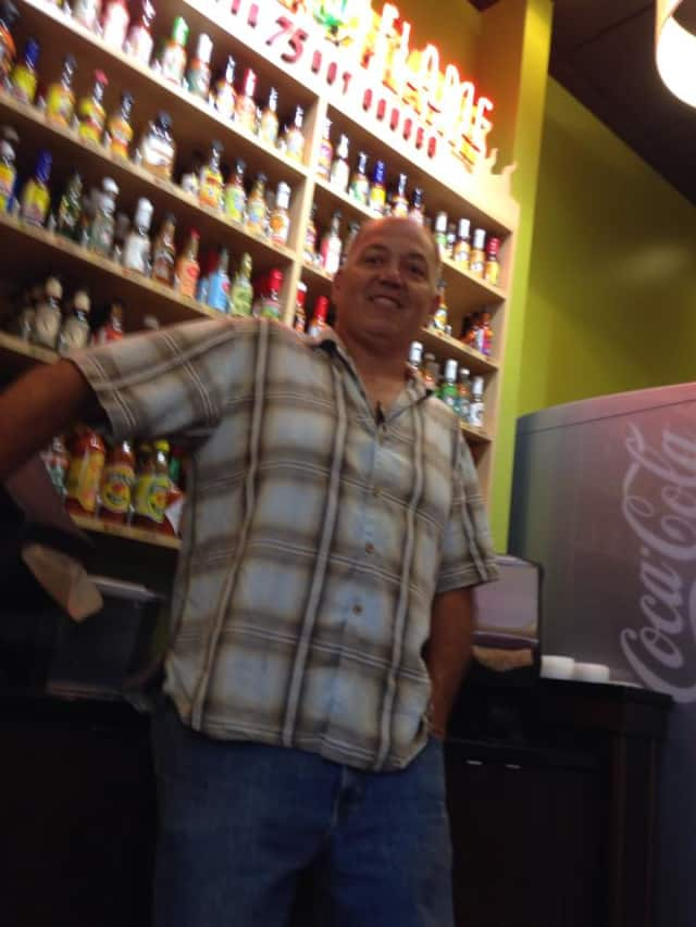 Paul Sanford stands against the Wall of Flame in California Tortillas of Montvale.