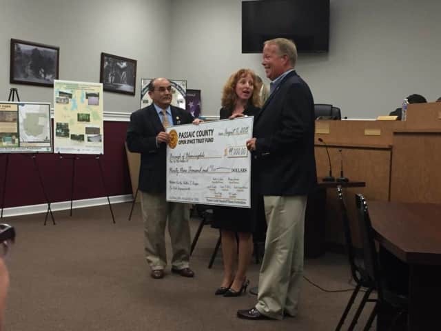 Freeholders Pat Lepore and Rhonda Cotroneo present an Open Space check for Walter T. Bergen field improvements to Mayor Dunleavy.