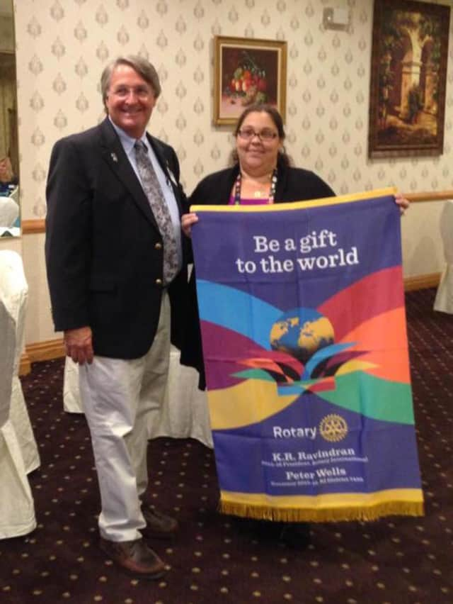 Garfield Rotary Club President Angela Mattina, right, with Rotary District Gov. Peter Wells.