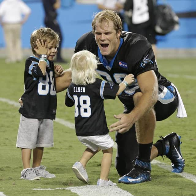 Wayne native Greg Olsen greets young Carolina Panther fans.