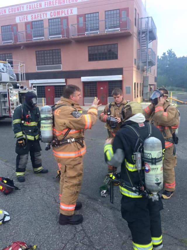 Montvale volunteer firefighters complete a training exercise this summer.
