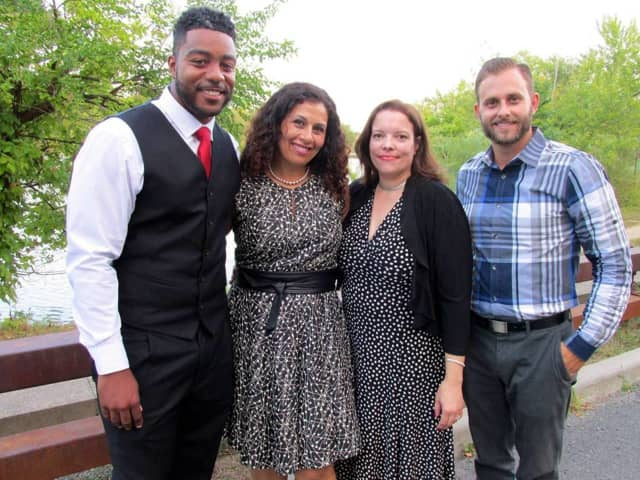 18 educators received tenure: (l-r) Theodore Washington (ALMS Physical Education Teacher), Inas Morsi (Trinity Assistant Principal), Lee Ann Rogers (IEYMS Speech Language Pathologist), and Marc Yannocone (NRHS Educational Technology Specialist).