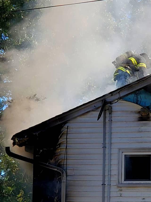 Firefighters battle blaze on Plympton Street in New Milford.