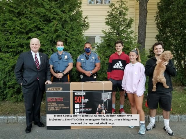 Four children from Madison were caught entirely off-guard when borough police surprised the family with a brand new portable basketball hoop to replace the one that had gotten destroyed during Tropical Storm Isaias in August.