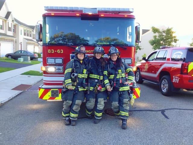 Firefighters Destinee Hartrum (left) and Stephanie Hartrum (right) recently graduated the Warren County Fire Academy joining Firefighter Deanna Harrington (center) as certified Washington Fire Department Station 83 firefighters.