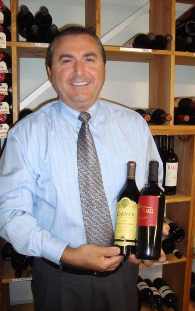 River Palm Terrace Manager Ali Osmani selects wine for the Edgewater event.