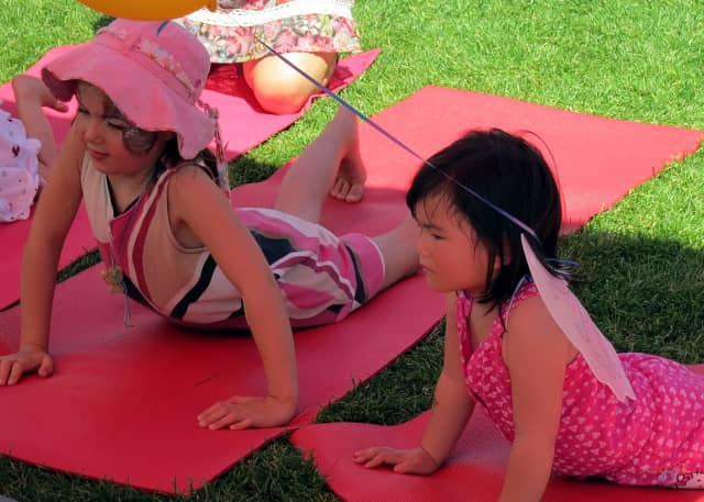 Youngsters like these can ward off kindergarten jitters with family yoga night at Westport Library.
