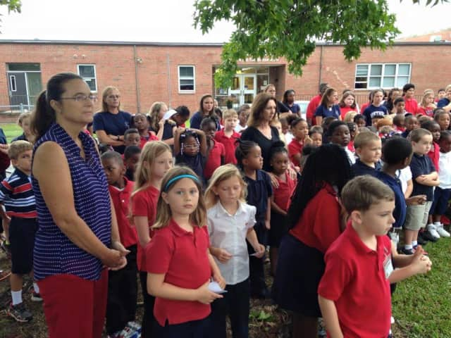 Students and faculty stand outside a school in Bethel in September. Bethel teachers may be nominated for the Dr. Janice Jordan Excellence in Education Award.