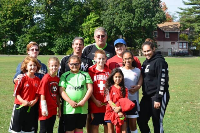 Bergenfield Mayor Norman Schmelz and volunteers have participated in the borough's Challenger programs that include sports for youngsters with special needs.