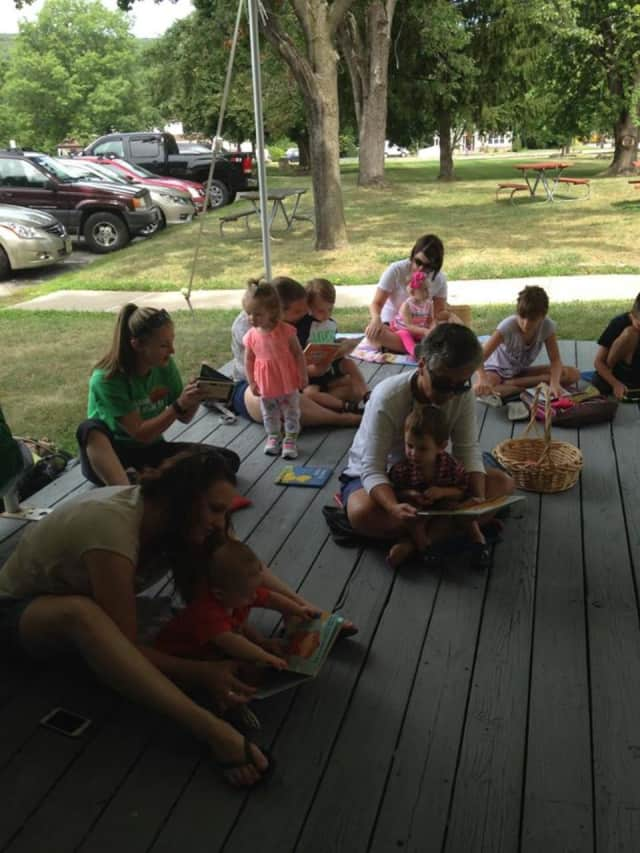 Families come together for a reading challenge at the New Milford Township Library during the summer.