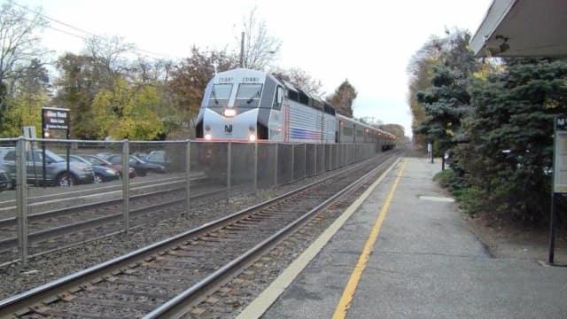 A train rolls into Glen Rock Borough Hall station.