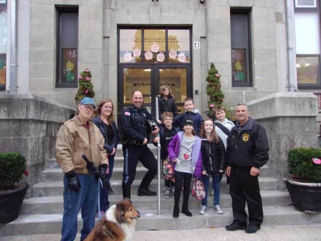 Rutherford Mayor Joe DeSalvo walks to Lincoln School with students.