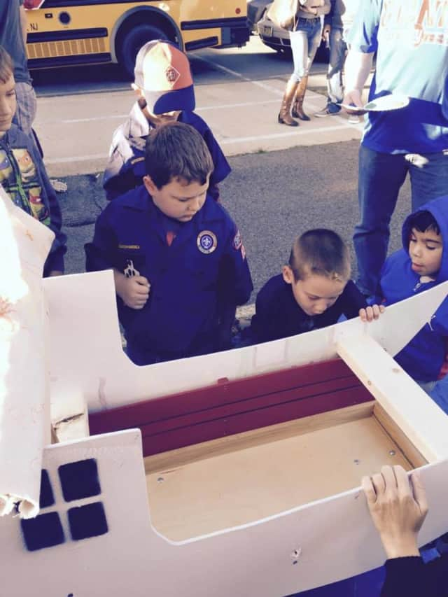 Saddle Brook Cub Scouts work on pinewood derby vehicles.