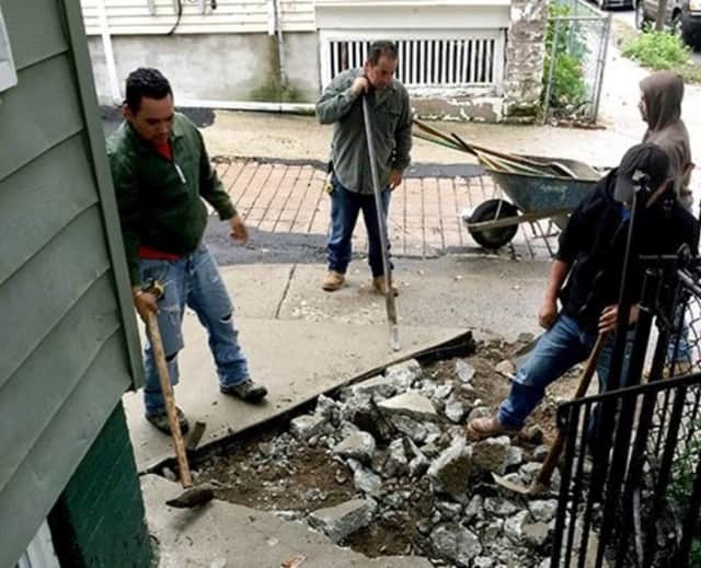 Giants of Generosity uses donations for construction on a community member's front steps.