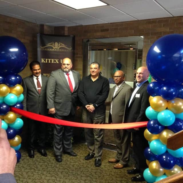 Montvale Mayor Roger Fyfe, second from left, joins Kitex Garments Ltd. at its Oct. 5 ribbon cutting ceremony.